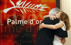 "Jury President Isabelle Huppert congratulates Director Michael Haneke after he won the Palme d'Or award for the film ""Das Weisse Band"" at the Cannes Film Festival on Sunday."