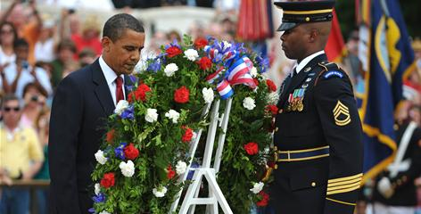 President Obama takes part in a wreath-laying ceremony at the Tomb of the Unknowns on Memorial Day at Arlington National Cemetery, in Arlington, Va.