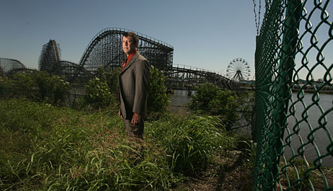 Community activist Joel Waltzer stands in front of Six Flags New Orleans, shuttered since Hurricane Katrina in 2005. Park operators and the city are sparring over the lease.