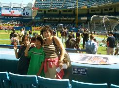 Sonia Sotomayor joins nephews Conner and Corey Sotomayor at Yankee Stadium in this undated photo.
