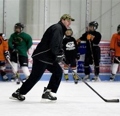 Safety on the ice: Keith Primeau demonstrates a drill for the kids' hockey team he coaches in Pennsauken, N.J. Primeau, who has agreed to donate his brain upon his death for a Sports Legacy Institute study, is especially careful about players with head injuries returning to the ice after his own NHL experiences.