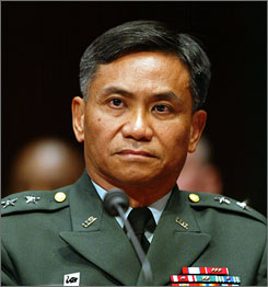 Retired Major Gen. Antonio Taguba, seen here testifying on Capitol Hill in Washington in 2004, is quoted in a British newspaper as saying he agreed with President Obama's decision not to release some photos of U.S. detainees in Iraq being abused.