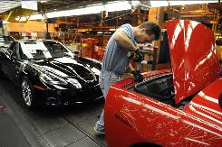 Scott Campbell, a General Motors assembly plant worker, finishes up a Corvette at the Bowling Green, Ky., plant.