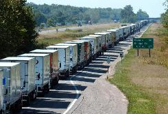 As new travel documentation requirements are put in place at U.S. border crossings Monday, officials are hoping to avoid scenes like this one: trucks backed up in Canada, 17 miles north of USA border on Sept. 12, 2001, the day after the 9/11 terror attacks on New York City and Washington, D.C.