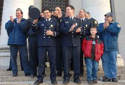 In New Haven, Conn., firefighters and supporters react to news in January that the Supreme Court will hear the reverse discrimination case of Ricci v. DeStefano, likely to be decided at the end of this month.
