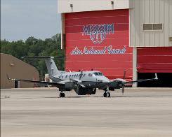 The first MC-12W Liberty Project aircraft, an Air Force manned intelligence, surveillance and reconnaissance plane, arrives at Key Field Air National Guard Base in Meridian, Miss., on April 28.