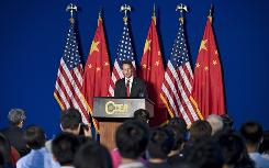 Treasury Secretary Timothy Geithner delivers a speech on Monday at the National School of Development at Beijing University in Beijing. Geithner kicked off a two-day visit by calling China and the United States indispensable partners in solving the global crisis and other urgent economic issues facing the world.