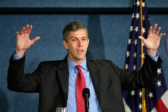 Education Secretary Arne Duncan talks about education reform at the National Press Club in Washington on May 29.