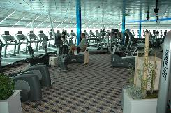Men use exercise bikes and treadmills in the gym on the Royal Caribbean cruise ship Freedom of the Seas. A new study shows that students who rode an exercise bike 20 minutes were in a better mood than those who didn't even 12 hours later.
