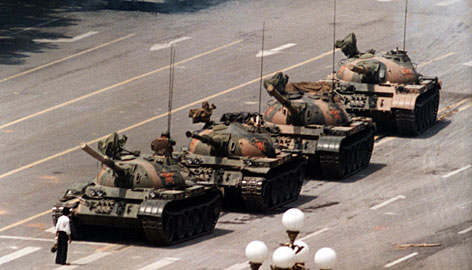 A Chinese man blocks a line of tanks heading east on Beijing's Changan Blvd. after Chinese forces crushed a pro-democracy demonstration in Tiananmen Square on June 5, 1989. The man was pulled away by bystanders, and the tanks continued on their way.