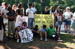 DeKalb County residents protest a proposed U.S Marine Corps academy during a school board meeting at Lakeside High School in Atlanta on June 1.