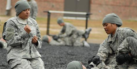 Staff Sgt. Anitra Randall, left, supervises Army recruits during basic training at Fort Jackson, S.C.