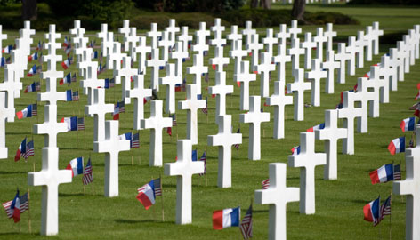 U.S. and French flags are seen by tombs at the American cemetery in Colleville-sur-Mer, France on Saturday prior to D-Day celebrations to mark the 65th anniversary of the June 6, 1944 allied landings in Normandy.