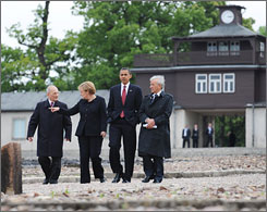 President Obama visits the site of the Buchenwald Nazi concentration camp in Germany on Friday with, from left to right, camp survivor Bertrand Herz, German Chancellor Angela Merkel and survivor and Nobel Peace Prize winner Elie Wiesel.