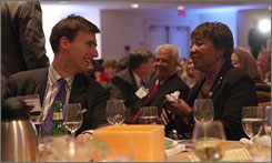 Texas Rep. Eddie Bernice Johnson speaks with Steven DeLuca of Capital One during a benefit dinner in Washington, D.C.