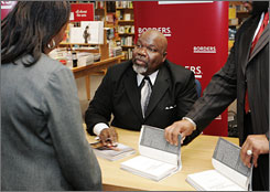 Pastor T.D. Jakes does a book signing in Washington, D.C., in 2007. Authorities are looking into a natural gas explosion at his Fort Worth home.