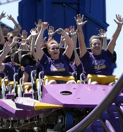 Roller coaster fans enjoy a ride on the newly transformed Bizarro coaster at Six Flags New England in Agawam, Mass., during a special event May 21.