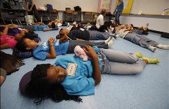 Fourth graders at Toluca Lake Elementary School in North Hollywood, Calif., learn meditation using exercises that include singing, breathing and well wishes toward others.