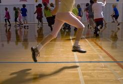 Increased time in PE classes can help children's attention and concentration and achievement test scores, according to a research review. 