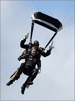 "Bush rides tandem with Sgt. 1st Class Mike Elliott as he celebrates his 85th birthday with a parachute jump on Friday. ""Just because you're an old guy, you don't have to sit around drooling in the corner,"" he said. ""Get out and do something. Get out and enjoy life."""