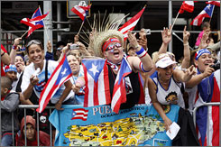 Spectators show their pride during the Puerto Rican Day Parade in New York City.