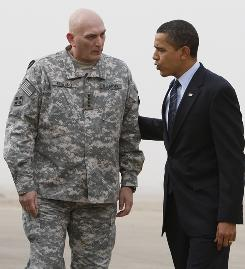 Gen. Ray Odierno, the top U.S. commander in Iraq, greets President Obama as he arrives in Baghdad on April 7.