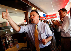 Creigh Deeds, left, campaigns with Sen. Mark Warner during a campaign event at a diner in Arlington, Va.