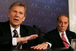 Former U.S. Sens. Tom Daschle, left, and Bob Dole make up half of the bipartisan team proposing a health overhaul that would require everyone to be insured while also charging large companies that don't provide coverage.