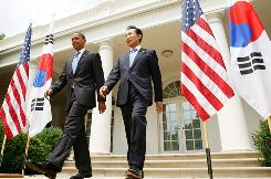 President Obama and South Korean leader Lee Myung Bak head for a news briefing at the White House on Tuesday in which they vowed to make North Korea think twice about its nuclear threats.