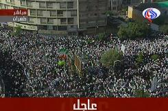 A video grab from the Arabic-language official Al-Alam television shows supporters of Iranian President Mahmoud Ahmadinejad rallying on Tuesday in Vali Asr Square in central Tehran.