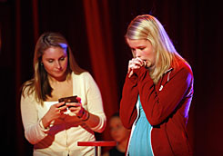 Kate Moore, 15, of Des Moines, has her texting device checked by a judge during the National Texting Championship in New York on Tuesday. To win, Moore competed in a series of events over two days to test texting speed, dexterity, nerves, athleticism and knowledge. She received a $50,000 prize.