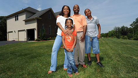 Lachelle and Dontae Carroll pose with daughter Camryn, 7, and son Brandon, 12, in their front yard in Charles County, Md. The county went from fewer than 40% minority youth in 2000 to more than 50% by 2008.