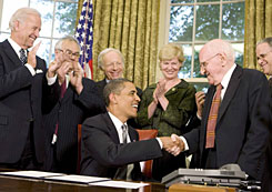 Obama shakes hands with gay rights activist Frank Kameny Wednesday after he extended benefits to same-sex partners of federal workers.