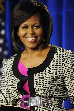 Michelle Obama, shown speaking Tuesday at a Greater DC Cares luncheon in Washington, will launch a summer service initiative Monday.