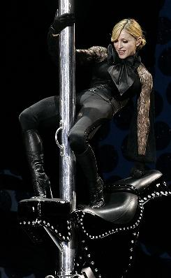 "Madonna performs at Rome's Olympic stadium during her ""Confessions Tour"" in 2006. Part of this concert included her appearing crucified on a giant cross, a move protested by the Vatican."