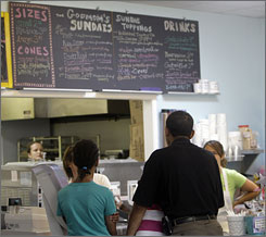President Obama, right, and daughter Malia, 10, order frozen custard at The Dairy Godmother in Alexandria, Va. Saturday. Daughter Sasha, 8, not pictured, ordered a brownie sundae treat.