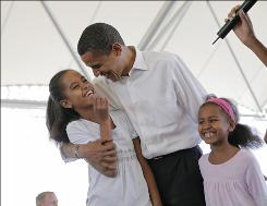 President Obama, with his two daughters, Malia, left, and Sasha, showcased fatherhood in a series of events and a magazine article in advance of Father's Day.