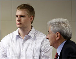 Phillip Markoff, left, stands with his attorney John Salsberg during his arraignment on Monday in Boston.