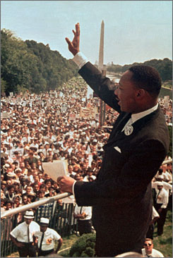 Four books written by the late Dr. Martin Luther King Jr. that have been out of print will be published again. Here, King waves to supporters at the 1963 March on Washington.