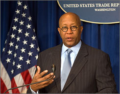 The administration is filing a trade case against China with the World Trade Organization accusing the country of restricting some exports to give Chinese manufacturers unfair advantages, U.S. trade representative Ron Kirk said Tuesday in Washington.