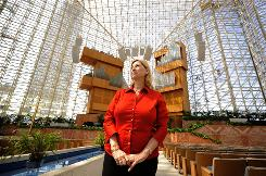 "Sheila Schuller Coleman stands in Crystal Cathedral in Garden Grove, Calif. ""It's very rare"" for a woman to take leadership of a megachurch, says Scott Thumma of the Hartford Institute for Religion Research."