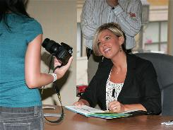 Kate Gosselin smiles at a book-signing for 'Eight Little Faces' and 'Multiple Blessings' at a Barnes & Noble in Glendale, Calif., April 14.