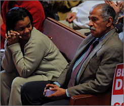 Detroit city councilwoman Monica Conyers, wife of Rep. John Conyers, D-Mich., has been charged with taking bribes. Here, the two await his introduction at a rally at a Detroit church in March.