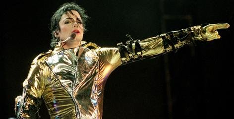 "Michael Jackson performs on stage during is ""HIStory"" world tour concert in Auckland, New Zealand in 1996."