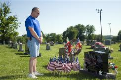 Steve Moore remembers his brother, Sgt. David Moore, at his grave in Dubois, Ind.