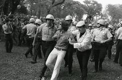 Chicago police haul away a demonstrator from Grant Park during the 1968 Democratic National Convention, which was marked by violent clashes between police and protesters.