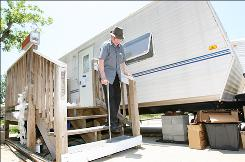 Chuck Rogers leaves his trailer in Biloxi, Miss., on June 16 to attend a City Council meeting. A deadline for FEMA trailer residents to vacate was extended.
