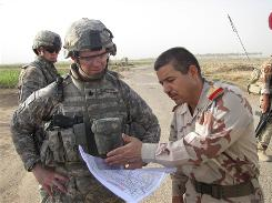 U.S. Army Lt. Col. Jim Bradford, left, and Iraqi Army Col. Kassem Latif Jassim look over a map during a recent joint mission west of Baghdad. Jassim says he can operate with a minimum of U.S. involvement in his area.