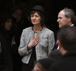 Federal judge Joan Lefkow watches her husband's casket carried into a church in Evanston, Ill., in March 2005. Lefkow's husband and mother were murdered by someone angered by one of the judge's decisions.