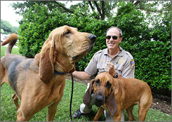 Fort Bend County Sheriff's Deputy Keith Pikett and two of his hounds, James Bond and Clue.